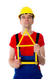 Worker with folding yardstick- house Royalty Free Stock Photo