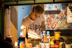 Food street market worker in Krakow Poland royalty free stock photography