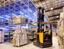 Worker on forklift Royalty Free Stock Photography