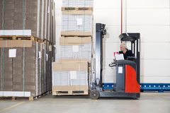 Worker In Forklift Examining Stockpile Stock Photos