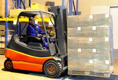 Worker and forklift loader at Royalty Free Stock Images
