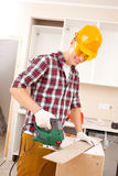Worker with a fretsaw Royalty Free Stock Photography