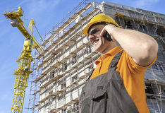Worker in front of construction site Royalty Free Stock Photography