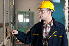 Worker in front of the dashboard Royalty Free Stock Photos