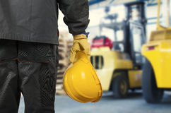 Worker in front of forklift Royalty Free Stock Image