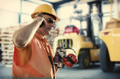 Worker in front of forklift Royalty Free Stock Images