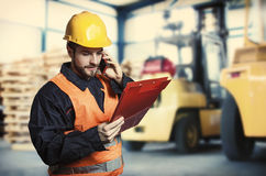Worker in front of forklift Stock Image