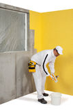 Worker in front of plastered wall Stock Image
