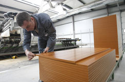 Worker in furniture factory royalty free stock images