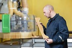 Worker at furniture manufacture workshop Stock Images
