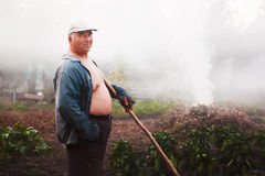 Worker in garden Royalty Free Stock Image