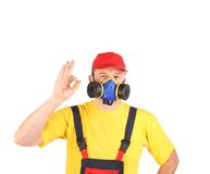 Worker in gas mask showing okay sign. Royalty Free Stock Image