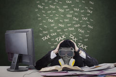 Worker with gas mask and tax documents Royalty Free Stock Photo