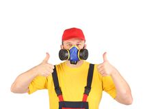 Worker in gas mask thumbs up. Royalty Free Stock Photography