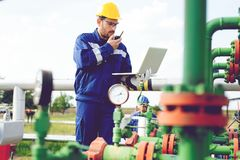 The worker of the gas refinery royalty free stock photography