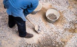 Worker gathering stone Stock Photos