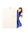 Worker girl with empty board and thumb up Royalty Free Stock Image