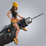Worker girl sitting on a drill stock photos