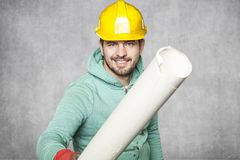 The worker gives construction plans for you. Protective helmet on the head Stock Photos
