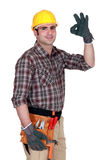 Worker giving sign of approval Royalty Free Stock Image
