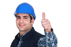 Worker giving the thumbs up Royalty Free Stock Image