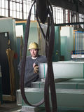 Worker in glass warehouse Stock Image