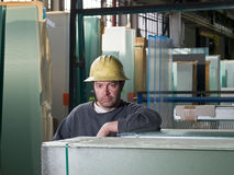 Worker in glass warehouse Royalty Free Stock Image