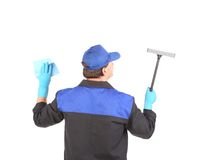 Worker in gloves with window cleaner. Royalty Free Stock Images