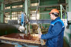 Worker on granite manufacture. Industrial worker at factory on granite or marble manufacture Royalty Free Stock Image