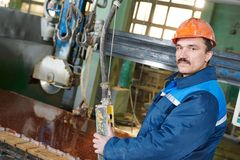 Worker on granite manufacture Stock Photos