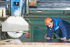 Worker on granite manufacture Royalty Free Stock Images