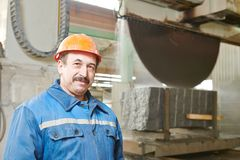 Worker on granite manufacture Stock Images