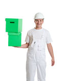 Worker with green boxes Royalty Free Stock Photo