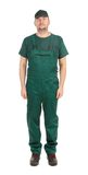 Worker in green overalls. Front Stock Images