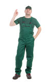 Worker in green overalls. Royalty Free Stock Image