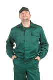 Worker in green workwear. Royalty Free Stock Images