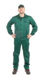Worker in green workwear. Isolated on a white background Stock Images