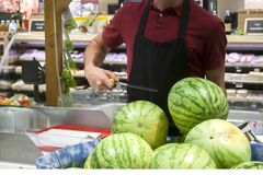 Worker. Greengrocer sells watermelons in a supermarket Stock Images
