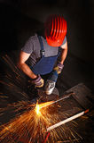 Worker with grinder stock photos