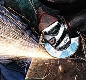 Worker grinding. The worker grinding (industrial photo Royalty Free Stock Photo