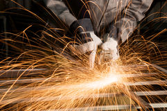 Worker grinding Stock Photo