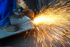 Worker grinding Stock Images