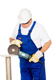 A worker grinding a chunk of iron Stock Photos
