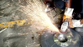 Worker grinding and cutting steel plate stock video footage