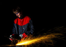 Worker grinding iron Stock Photo