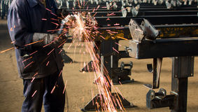 Worker grinding metal with angle grinder. Worker grinding metal with a angle grinder Royalty Free Stock Photo