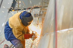 Worker grinding metal Royalty Free Stock Images