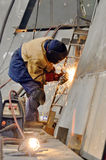 Worker grinding metal Royalty Free Stock Photography