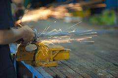 Worker is grinding metal. Part Stock Photos
