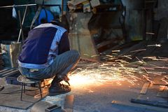 Worker grinding steel Royalty Free Stock Images